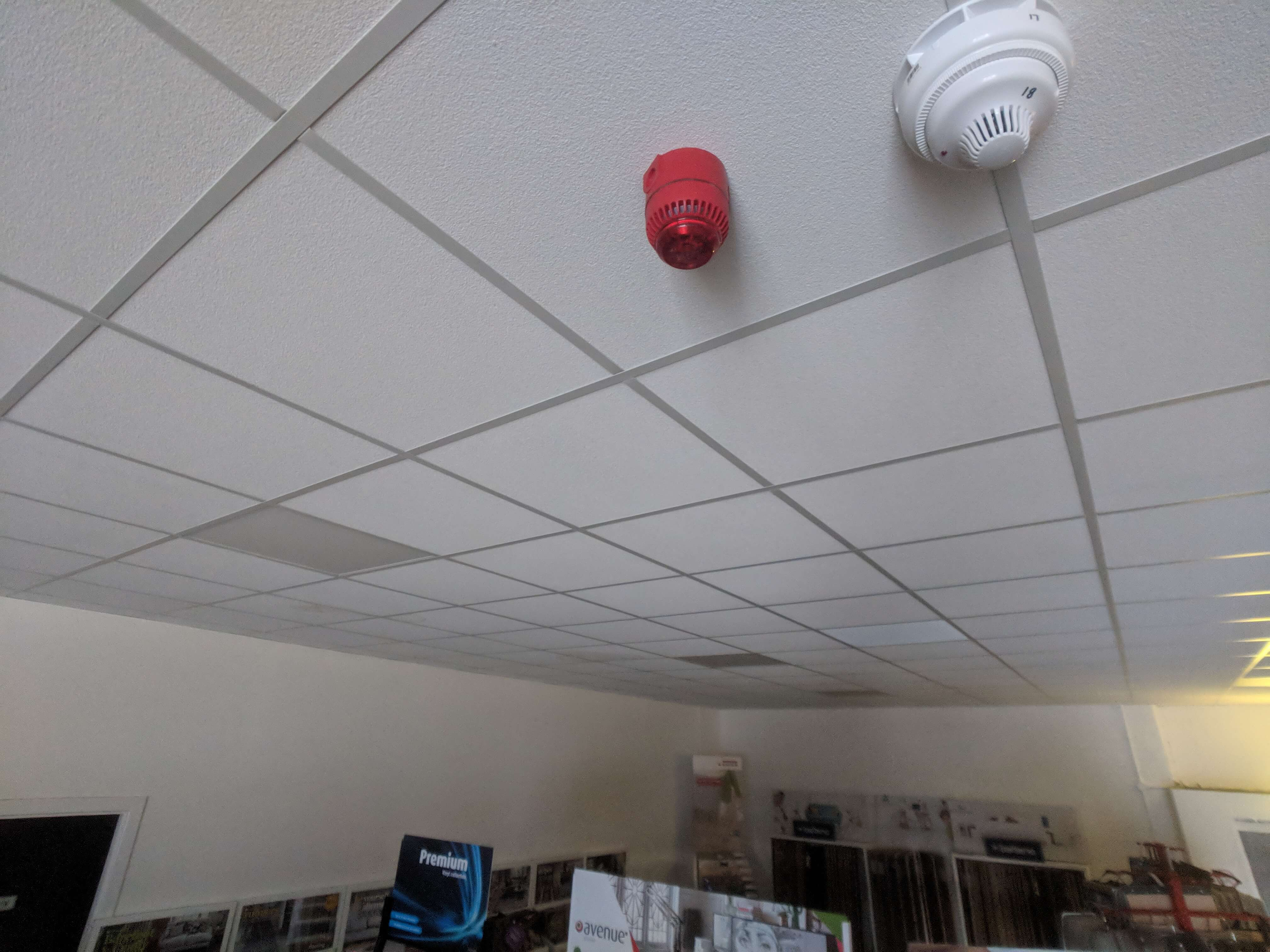 Supended ceiling with smoke alarm
